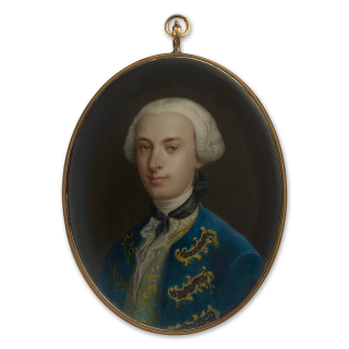 Portrait miniature of a young Nobleman, wearing dark blue coat with gold brocade, pale green waistcoat and white lace shirt, his powdered wig 'bagged' with black silk, c.1760