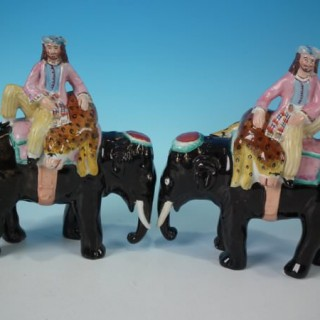 Pair Staffordshire Pottery Mahouts on Elephants