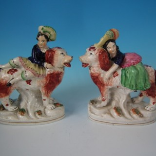 Pair Staffordshire Royal children on spaniels