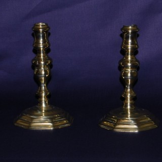 Pair of early 18th. century Brass octagonal base candlesticks