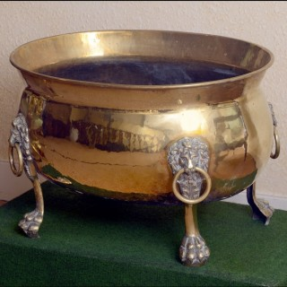 A large Regency brass oval wine cooler
