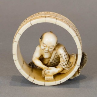 NICE QUALITY JAPANESE IVORY OKIMONO OF A BARREL MAKER