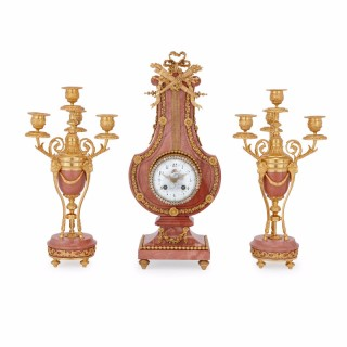Neoclassical style ormolu mounted pink marble clock set