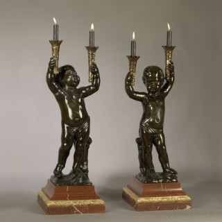Pair of Patinated Bronze Figural Torcheres