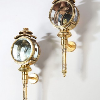 A pair of brass carriage lamps
