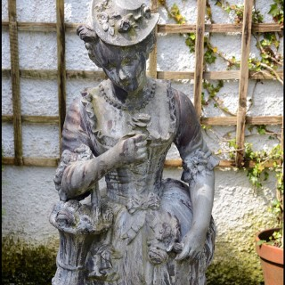 Pair late 18th century continental lead garden figures