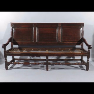 A Late 17th Century William and Mary Panel Backed Oak Hall Settle