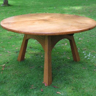 A 20th Century Cotswolds School Oak Circular Dining Table
