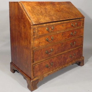A George II Period Solid Elm Bureau