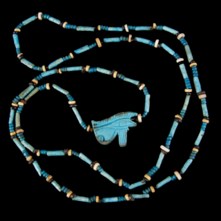 NECKLACE OF ANCIENT EGYPTIAN BEADS WITH WEDJAT