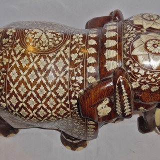 An Anglo-Indian carved andbone  inlaid  elephant