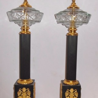 Pair of French gilt and patinated bronze lamps