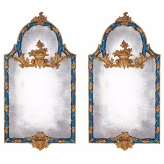 Pair of Italian carved giltwood and blue painted mirrors