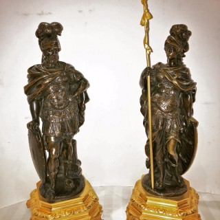 A pair of patinated bronze figures by Moreau