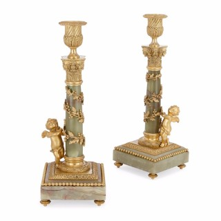 Pair of French green onyx and gilt metal candlesticks