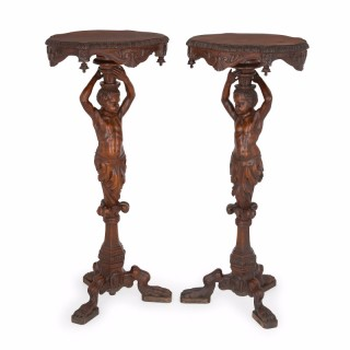 Pair of antique carved walnut Baroque style side tables