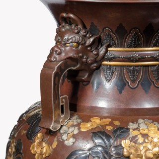 A pair of exhibition quality Meiji period rotating bronze and mixed metal vases