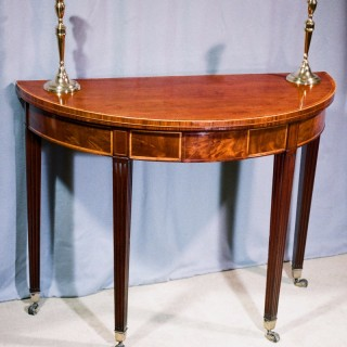 George III period mahogany and inlaid demi- lune fold over top tea table