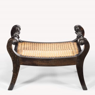 A pair of Anglo Indian solid ebony footstools
