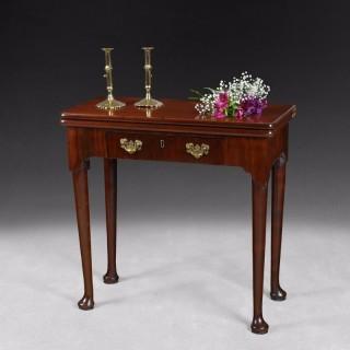 Mid 18th. century mahogany fold over top tea table