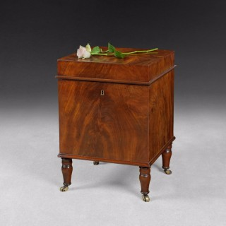 Regency Mahogany wine cooler on turned legs.