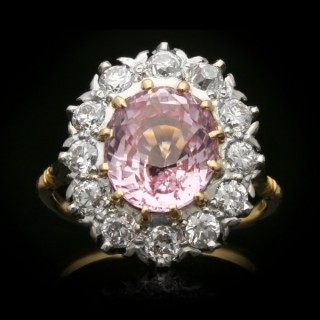 Natural Padparadscha sapphire and diamond coronet cluster ring, circa 1910.