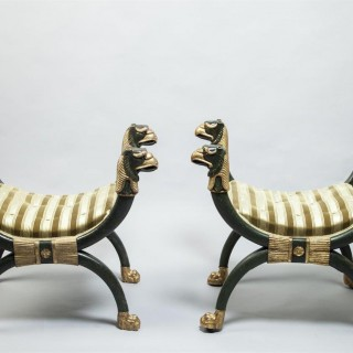 A Pair of Regency Parcel Gilt and Ebonised Cross Frame Stools