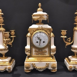 A French ormolu and marble three piece clock set