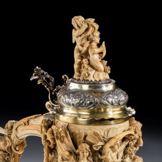 A  German ivory and parcel gilt tankard