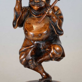JAPANESE WOODEN OKIMONO OF A DANCING DRUMMER BOY