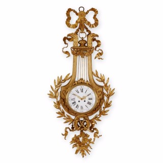 Gilt bronze (ormolu) lyre backplate wall clock in the style of Louis XVI