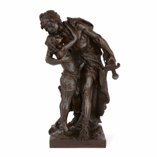 Patinated bronze antique figural group depicting father and son, by Henri Plé