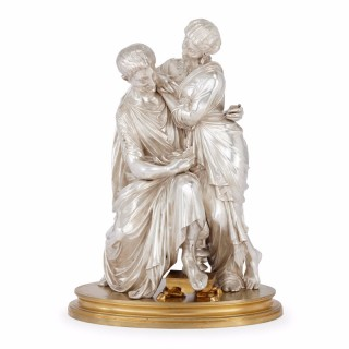 Silvered and gilt bronze antique French figural group of a couple by F. T. Devaulx
