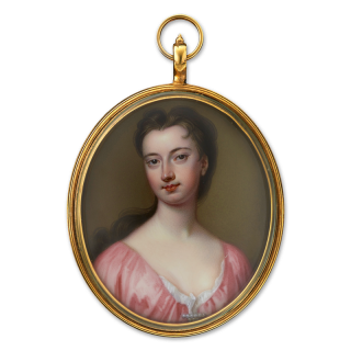 Portrait enamel of a Lady, wearing pink gown with white underslip, a pearl bar brooch at her corsage c.1730