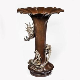 A Meiji period bronze trumpet vase with a dragon