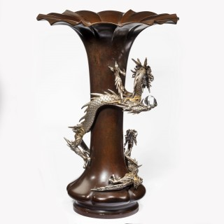 A Meiji period bronze trumpet vase with a dragon