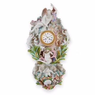 Antique  Meissen style porcelain cartel clock with mythological decorations