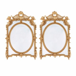 Pair of Neoclassical style embellished antique giltwood French mirrors