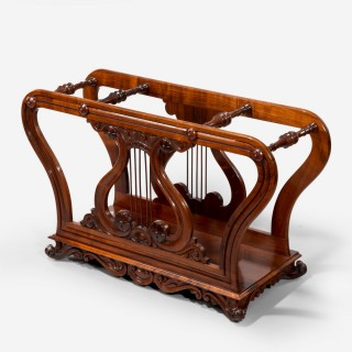 An unusual late Regency rosewood music roll holder