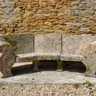 An early 20th century carved Bath stone garden seat