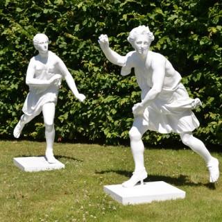 A pair of painted zinc statues of Hippomenes and Atalanta
