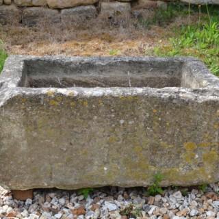 A small Bath stone trough