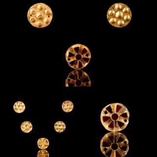 Set of Five Gold and Garnet Appliques