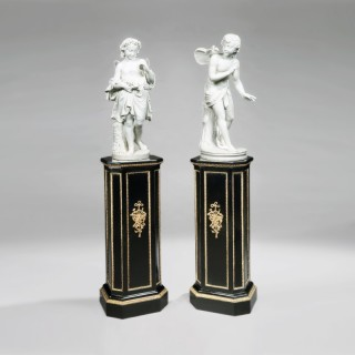 Pair of Ebonised and Gilt Bronze Pedestals