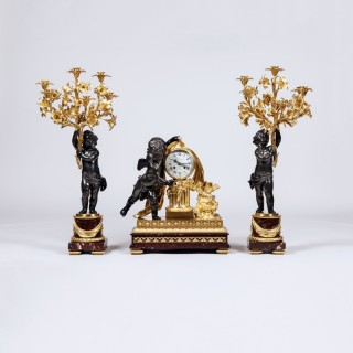 French Bronze and Gilt Bronze Mantel Clock and Candelabra