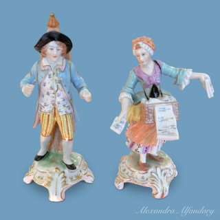 A Pair of Collectable Dresden Magic Lantern/Peepshow Figurines
