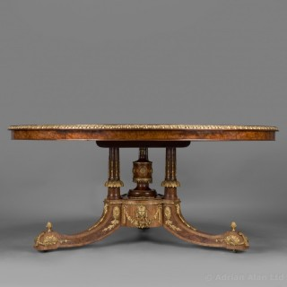 An Exhibition Quality Gilt-Bronze Mounted Amboyna and Satinwood Centre Table