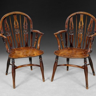 Pair of George III period Yewwood and Elm triple splat draught back Windsor Armchairs