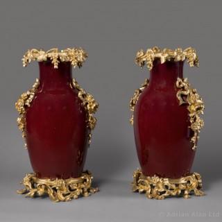 Pair of Gilt-Bronze Sang-de-Boeuf Glazed Porcelain Vases