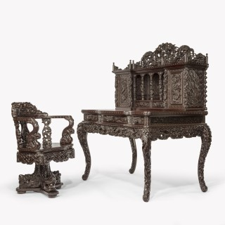 A Meiji period carved hardwood desk and chair